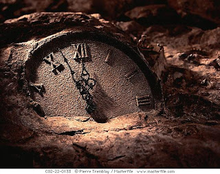 © Pierre Tremblay/Masterfile  Clock face in rock