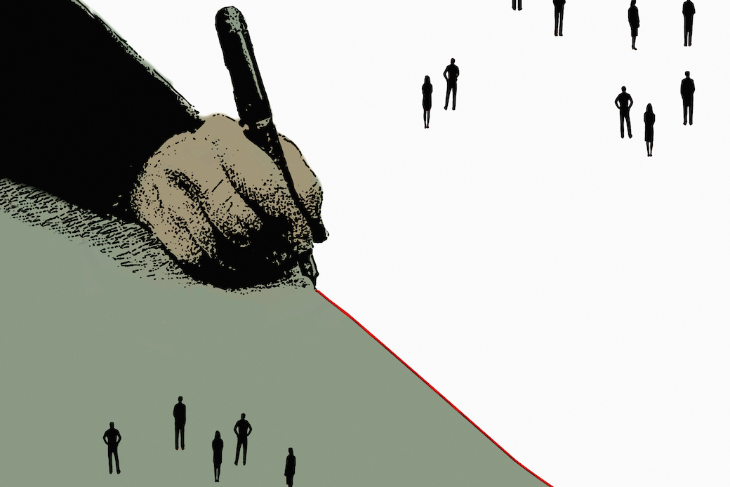 Hand drawing red dividing line separating groups of people
